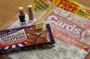 Two nail varnishes, a bar of chocolate and a card-making magazine