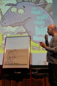Richard Byrne, writer and illustrator of The Really, Really, Really Big Dinosaur (winner of the picture book category) draws one of the characters from the book
