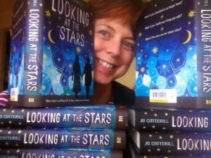 Me with my author copies of Looking at the Stars