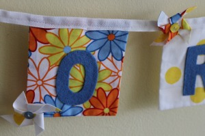 Details on letters O and R - pinwheels made using two different fabrics stuck together using Bondaweb