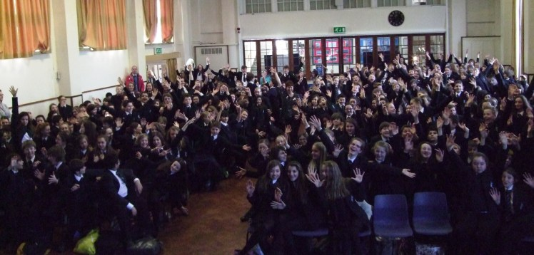 I'm the tiny one in the middle, wearing the same colour as the school uniform! (note to self: next time wear RED!)