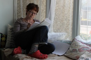 Me, reading my 'wafty' story (that's a story begun without a real plot, just characters and an idea) on the window seat