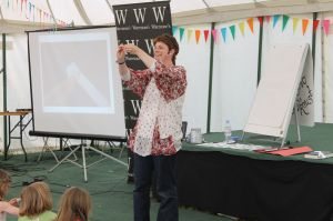 Me demonstrating the folding technique in a wish star - you can see the powerpoint image on the screen to the left
