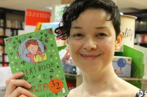 Susie with her shiny new book, Pea's Book of Holidays