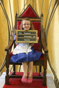 Jemima, dressed as Alice, with her first choice of words