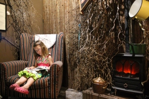 Jemima listens to the extract whilst reading along - book provided in each room