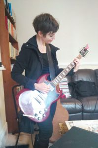 Helen Stickland on electric guitar