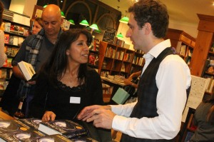 Jonathan signing for starstruck author Savita Kalhan, with another author Sarwat Chadda, next in the queue