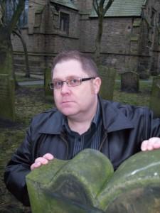 Celebrated writer Tommy Donbavand, hiding behind gravestones when he's not defacing windows