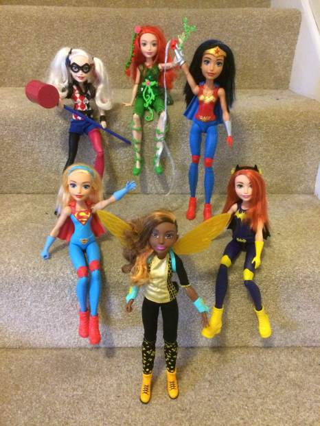 Back row, l-r: Harley Quinn, Poison Ivy, Wonder Woman. Front row, l-r: Supergirl, Bumblebee, Batgirl
